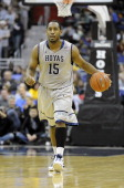 Austin Freeman of the Georgetown Hoyas brings the ball up the court against the Loyola Greyhounds at the Verizon Center on December 18 2010 in...