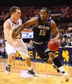 Austin Freeman of the Georgetown Hoyas drives to the basket as Ben Hansbrough of the Notre Dame Fighting Irish defends on December 29 2010 in South...