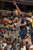 Austin Freeman of the Georgetown Hoyas goes up for a shot against Devin Brooks of the West Virginia Mountaineers on January 22 2009 at Verizon Center...