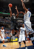 Austin Freeman of the Georgetown Hoyas shoots a layup against Will Coleman of the Memphis Tigers on December 23 2010 at FedExForum in Memphis...