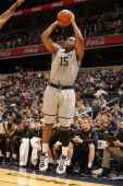 Austin Freeman of the Georgetown Hoyas takes a jump shot during a college basketball game against the Appalachian Mountaineers on December 12 2010 at...