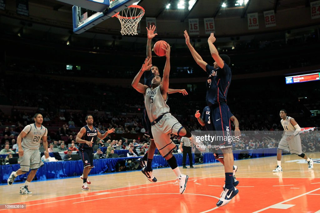 Austin Freeman of the Gerogetown Hoyas shoots the ball up over Shabazz Napier of the Connecticut Huskies during the second round of the 2011 Big East...