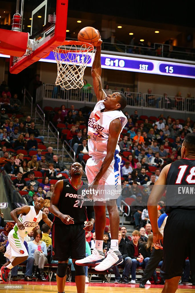Austin Freeman of the Iowa Energy dunks as Henry Walker of the Sioux Falls Skyforce watches in an NBA DLeague game on February 1 2014 at the Wells...