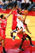 Austin Freeman of the Iowa Energy looks for his shot past Tony Bishop of the Rio Grande Valley Vipers in an NBA DLeague game on March 9 2014 at the...