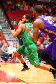 Austin Freeman of the Iowa Energy rushes into the paint past Travis Hyman of the Los Angeles DFenders in an NBA DLeague game on April 5 2014 at the...