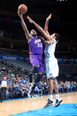Austin Freeman of the Iowa Energy shoots against Grant Jerrett of the Tulsa 66ers during an NBA DLeague game on February 4 2014 at the Chesapeake...