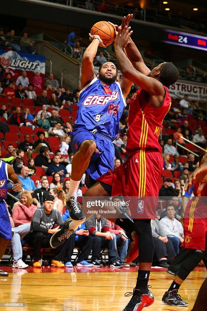 Austin Freeman of the Iowa Energy shoots over Tony Mitchell of the Fort Wayne Mad Ants in an NBA DLeague game on January 18 2014 at the Wells Fargo...
