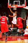 Austin Freeman of the Iowa Energy takes a reverse layup past Akeem Ellis of the Rio Grande Valley Vipers in an NBA DLeague game on March 9 2014 at...