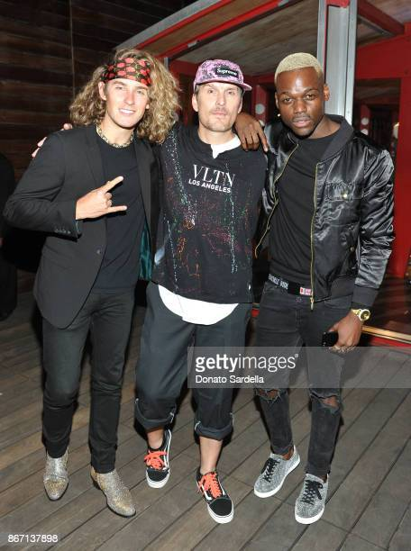 Austin Gain Balthazar Getty and guest attend Valentino VLTN Maxfield pop up store opening at Maxfield on October 26 2017 in Los Angeles California