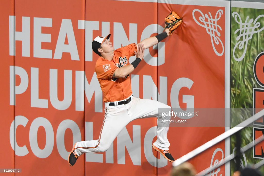 Austin Hays #18 of the Baltimore Orioles catches a fly ball hit by Adeiny Hechavarria #11 of the Tampa Bay Rays (not pictured) in the seventh inning during a baseball game at Oriole Park at Camden Yards on September 23, 2017 in Baltimore, Maryland.