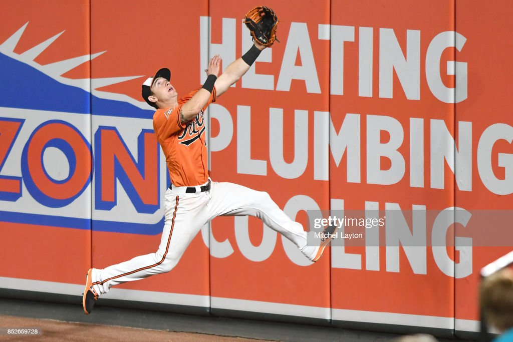 Austin Hays #18 of the Baltimore Orioles runs to catch a fly ball hit by Adeiny Hechavarria #11 of the Tampa Bay Rays (not pictured) in the seventh inning during a baseball game at Oriole Park at Camden Yards on September 23, 2017 in Baltimore, Maryland.