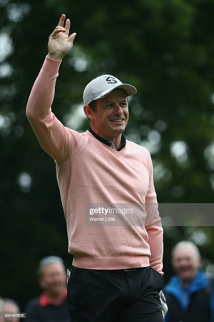 <a gi-track='captionPersonalityLinkClicked' href=/galleries/search?phrase=Austin+Healey&family=editorial&specificpeople=211535 ng-click='$event.stopPropagation()'>Austin Healey</a> reacts during the Pro-Am prior to the BMW PGA Championship at Wentworth on May 25, 2016 in Virginia Water, England.