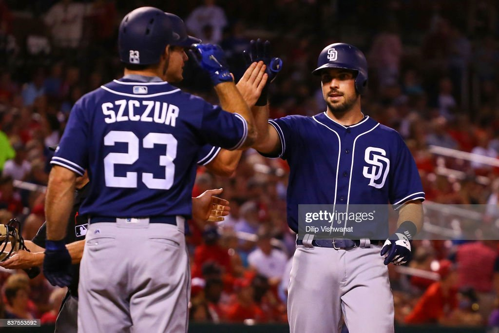 Austin Hedges #18 of the San Diego Padres is congratulated by his teammates after hitting a three-run home run against the St. Louis Cardinals in the seventh inning at Busch Stadium on August 22, 2017 in St. Louis, Missouri.