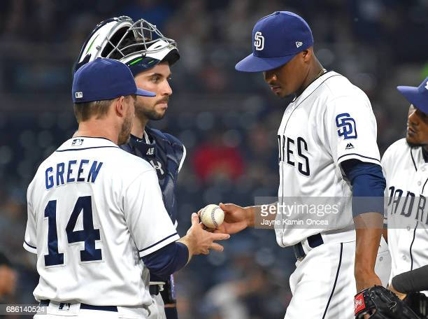 Austin Hedges of the San Diego Padres looks on as Luis Perdomo hands the ball to manager Andy Green as he is pulled from the third inning of the game...