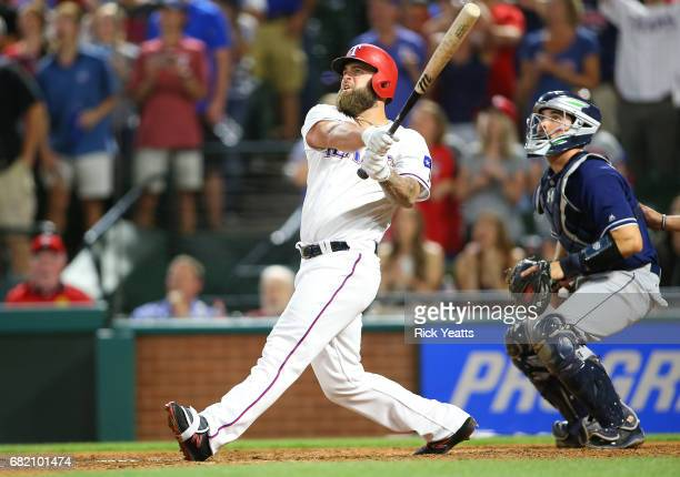 Austin Hedges of the San Diego Padres looks on as Mike Napoli of the Texas Rangers hits a threerun walkoff home run in the ninth inning at Globe Life...