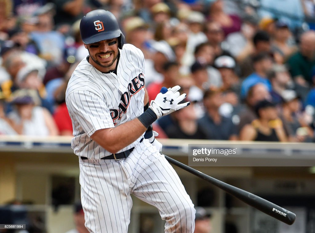 Austin Hedges #18 of the San Diego Padres reacts after hitting a fly ball during the seventh inning of a baseball game against the Minnesota Twins at PETCO Park on August 2, 2017 in San Diego, California.