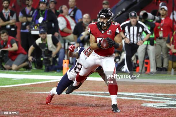 Austin Hooper of the Atlanta Falcons catches a 19 yard touchdown against Patrick Chung of the New England Patriots in the second quarter during Super...