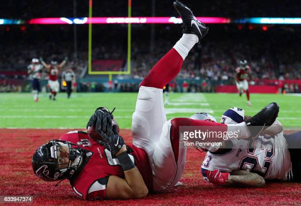 Austin Hooper of the Atlanta Falcons makes a 19yard touchdown reception against Patrick Chung of the New England Patriots in the second quarter of...