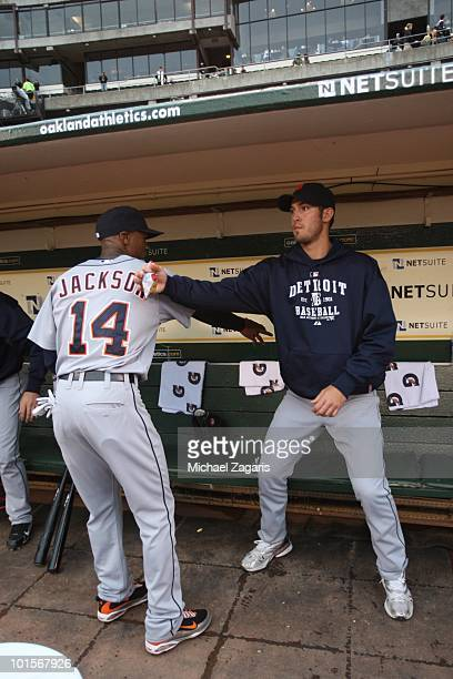 Austin Jackson and Rick Porcello of the Detroit Tigers doing a pregame ritual in the dugout prior to the game against the Oakland Athletics at the...