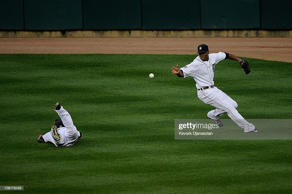 Austin Jackson #14 fields the ball as Ryan Raburn #25 of the Detroit Tigers fails to make a catch on a hit by David Murphy #7 of the Texas Rangers in the sixth inning of Game Five of the American League Championship Series at Comerica Park on October 13, 2011 in Detroit, Michigan.