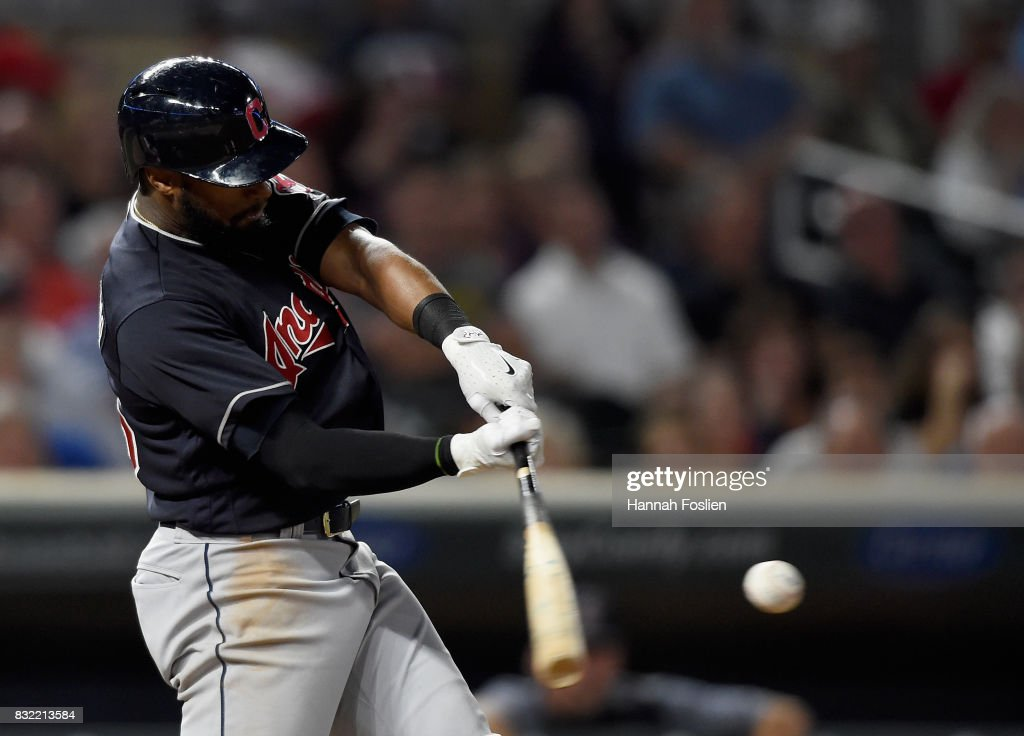 Austin Jackson #26 of the Cleveland Indians hits a three-run home run against the Minnesota Twins during the seventh inning of the game on August 15, 2017 at Target Field in Minneapolis, Minnesota. The Indians defeated the Twins 8-1.