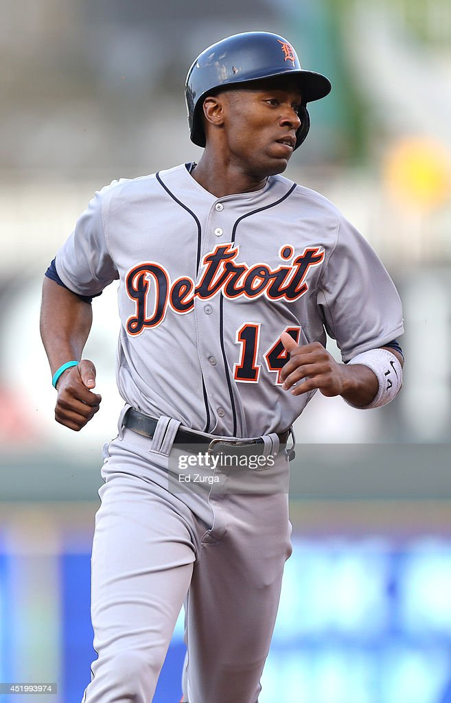 <a gi-track='captionPersonalityLinkClicked' href=/galleries/search?phrase=Austin+Jackson&family=editorial&specificpeople=608633 ng-click='$event.stopPropagation()'>Austin Jackson</a> #14 of the Detroit Tigers advances to third on a Ian Kinsler single in the first inning during a game against the Kansas City Royals at Kauffman Stadium on July 10, 2014 at Kauffman Stadium in Kansas City, Missouri.