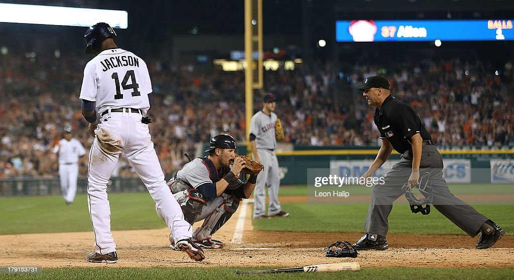 <a gi-track='captionPersonalityLinkClicked' href=/galleries/search?phrase=Austin+Jackson&family=editorial&specificpeople=608633 ng-click='$event.stopPropagation()'>Austin Jackson</a> #14 of the Detroit Tigers beats the tag by catcher <a gi-track='captionPersonalityLinkClicked' href=/galleries/search?phrase=Yan+Gomes&family=editorial&specificpeople=9004037 ng-click='$event.stopPropagation()'>Yan Gomes</a> #10 of the Cleveland Indians on the Jose Iglesias #1 sacrifice during the eighth inning of the game against the Cleveland Indians at Comerica Park on August 31, 2013 in Detroit, Michigan. The Tigers defeated the Indians 10-5.