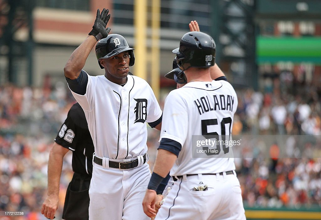 <a gi-track='captionPersonalityLinkClicked' href=/galleries/search?phrase=Austin+Jackson&family=editorial&specificpeople=608633 ng-click='$event.stopPropagation()'>Austin Jackson</a> #14 of the Detroit Tigers celebrates after hitting a three run home in the sixth inning scoring Jose Iglesias #1 and Bryan Holaday #50 during the game against the Minnesota Twins at Comerica Park on August 22, 2013 in Detroit, Michigan.