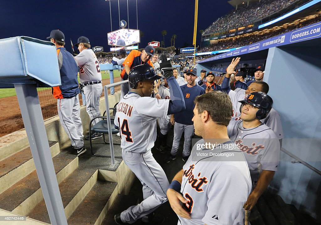 <a gi-track='captionPersonalityLinkClicked' href=/galleries/search?phrase=Austin+Jackson&family=editorial&specificpeople=608633 ng-click='$event.stopPropagation()'>Austin Jackson</a> #14 of the Detroit Tigers celebrates in the dugout with teammates afte hitting a solo second inning home run against pitcher Dan Haren #14 of the Los Angeles Dodgers (not in photo) during the MLB game at Dodger Stadium on April 8, 2014 in Los Angeles, California. The Dodgers defeated the Tigers 3-2 in 10 innings.