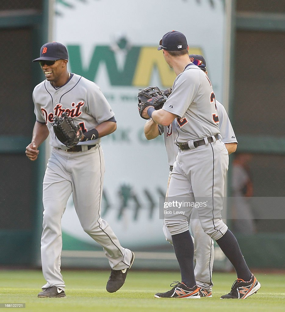 <a gi-track='captionPersonalityLinkClicked' href=/galleries/search?phrase=Austin+Jackson&family=editorial&specificpeople=608633 ng-click='$event.stopPropagation()'>Austin Jackson</a> #14 of the Detroit Tigers celebrates with Don Kelly #32 of the Detroit Tigers and <a gi-track='captionPersonalityLinkClicked' href=/galleries/search?phrase=Andy+Dirks&family=editorial&specificpeople=7511216 ng-click='$event.stopPropagation()'>Andy Dirks</a> #12 of the Detroit Tigers after the final out against the Houston Astros at Minute Maid Park on May 5, 2013 in Houston, Texas.