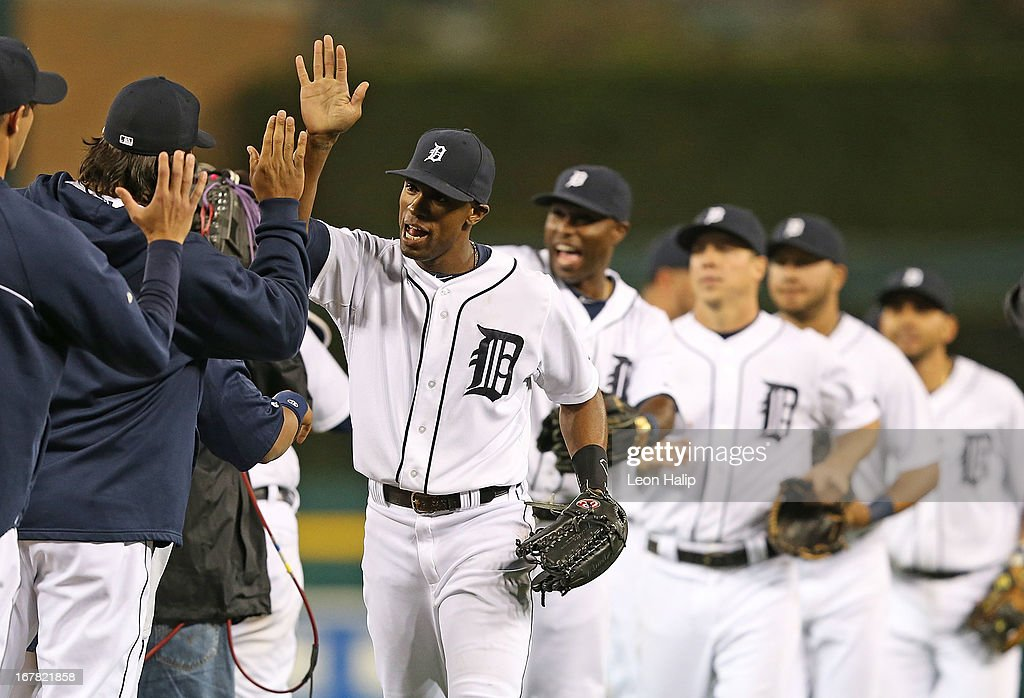 <a gi-track='captionPersonalityLinkClicked' href=/galleries/search?phrase=Austin+Jackson&family=editorial&specificpeople=608633 ng-click='$event.stopPropagation()'>Austin Jackson</a> #14 of the Detroit Tigers celebrates with his teammates after beating the Minnesota Twins at Comerica Park on April 30, 2013 in Detroit, Michigan. The Tigers defeated the Twins 6-1.