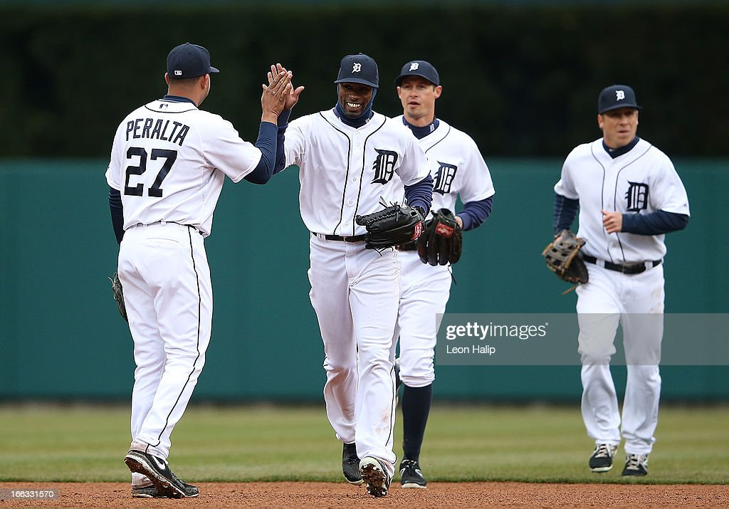 <a gi-track='captionPersonalityLinkClicked' href=/galleries/search?phrase=Austin+Jackson&family=editorial&specificpeople=608633 ng-click='$event.stopPropagation()'>Austin Jackson</a> #14 of the Detroit Tigers celebrates with teammate <a gi-track='captionPersonalityLinkClicked' href=/galleries/search?phrase=Jhonny+Peralta&family=editorial&specificpeople=213286 ng-click='$event.stopPropagation()'>Jhonny Peralta</a> #27 after the Tigers defeated the Blue Jays at Comerica Park on April 11, 2013 in Detroit, Michigan. The Tigers defeated the Blue Jays 11-1.