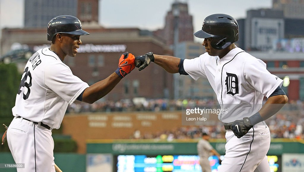 <a gi-track='captionPersonalityLinkClicked' href=/galleries/search?phrase=Austin+Jackson&family=editorial&specificpeople=608633 ng-click='$event.stopPropagation()'>Austin Jackson</a> #14 of the Detroit Tigers celebrates with teammate <a gi-track='captionPersonalityLinkClicked' href=/galleries/search?phrase=Torii+Hunter&family=editorial&specificpeople=183408 ng-click='$event.stopPropagation()'>Torii Hunter</a> #48 after hitting a solo home run in the fifth inning during the game against the Chicago White Sox at Comerica Park on August 2, 2013 in Detroit, Michigan.
