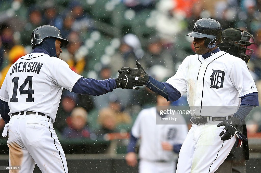 <a gi-track='captionPersonalityLinkClicked' href=/galleries/search?phrase=Austin+Jackson&family=editorial&specificpeople=608633 ng-click='$event.stopPropagation()'>Austin Jackson</a> #14 of the Detroit Tigers celebrates with teammate Torri Hunter #48 after scoring on the double to deep center field by <a gi-track='captionPersonalityLinkClicked' href=/galleries/search?phrase=Prince+Fielder&family=editorial&specificpeople=209392 ng-click='$event.stopPropagation()'>Prince Fielder</a> #28 in the fifth inning of the game against the Toronto Blue Jays at Comerica Park on April 11, 2013 in Detroit, Michigan. The Tigers defeated the Blue Jays 11-1.