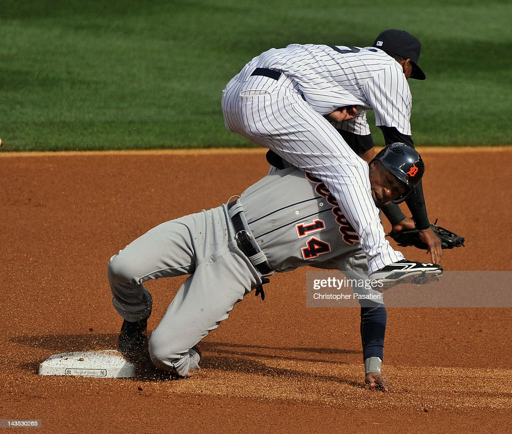 <a gi-track='captionPersonalityLinkClicked' href=/galleries/search?phrase=Austin+Jackson&family=editorial&specificpeople=608633 ng-click='$event.stopPropagation()'>Austin Jackson</a> #14 of the Detroit Tigers collides with <a gi-track='captionPersonalityLinkClicked' href=/galleries/search?phrase=Eduardo+Nunez&family=editorial&specificpeople=4900197 ng-click='$event.stopPropagation()'>Eduardo Nunez</a> #26 of the New York Yankees as he steals second base in the top of the first inning against the New York Yankees at Yankee Stadium on April 28, 2012 in the Bronx borough of New York City.