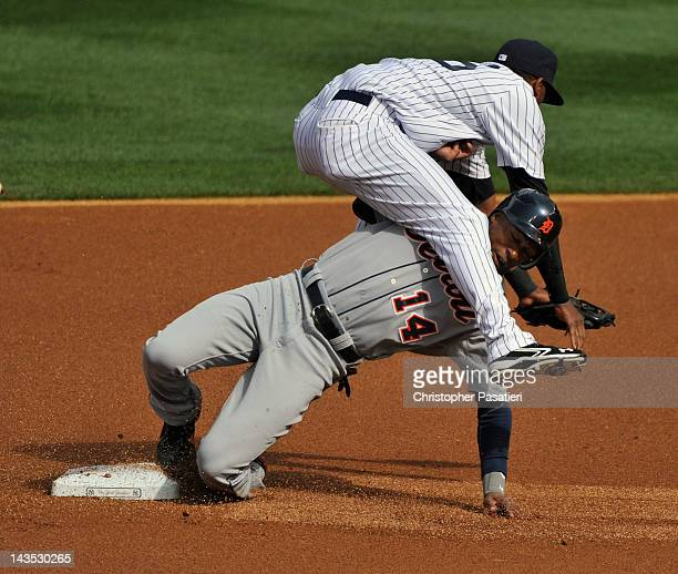 Austin Jackson of the Detroit Tigers collides with Eduardo Nunez of the New York Yankees as he steals second base in the top of the first inning...