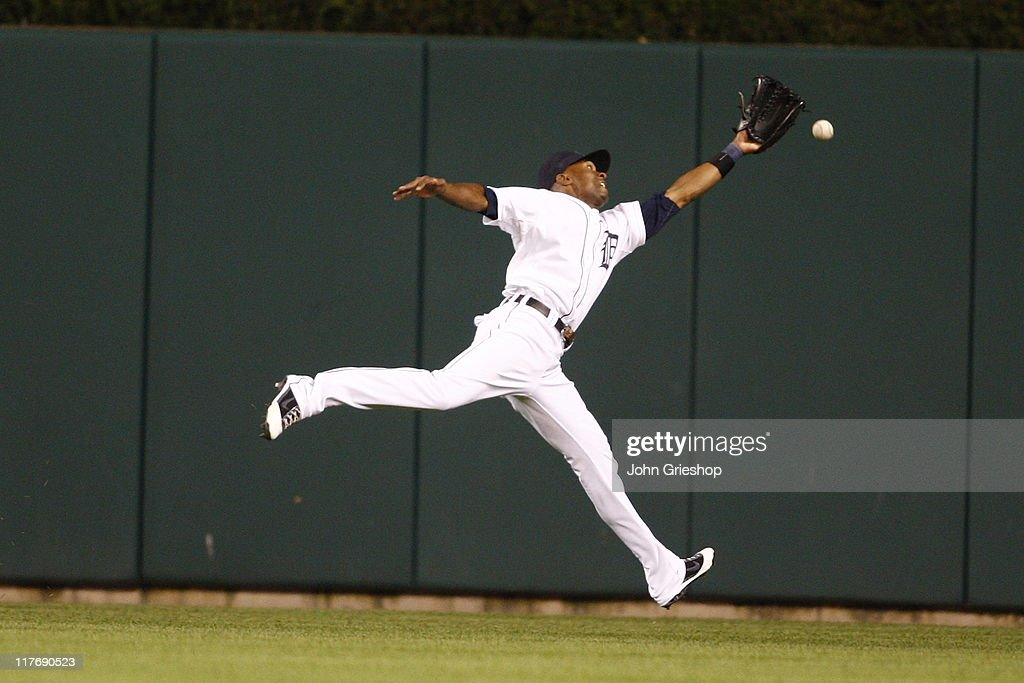 <a gi-track='captionPersonalityLinkClicked' href=/galleries/search?phrase=Austin+Jackson&family=editorial&specificpeople=608633 ng-click='$event.stopPropagation()'>Austin Jackson</a> #14 of the Detroit Tigers comes up short in centerfield during the game against the New York Mets on June 29, 2011 at Comerica Park in Detroit, Michigan. The Mets defeated the Tigers 16-9.