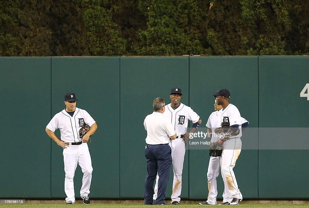 <a gi-track='captionPersonalityLinkClicked' href=/galleries/search?phrase=Austin+Jackson&family=editorial&specificpeople=608633 ng-click='$event.stopPropagation()'>Austin Jackson</a> #14 of the Detroit Tigers gets checked out by head trainer Kevin Rand after hitting the wall on the fly ball inside the park home run from Carlos Santana #41 of the Cleveland Indians in the eighth inning of the game at Comerica Park on August 31, 2013 in Detroit, Michigan. The Tigers defeated the Indians 10-5.