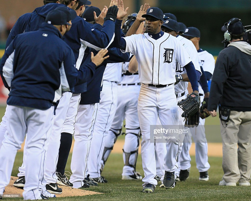 <a gi-track='captionPersonalityLinkClicked' href=/galleries/search?phrase=Austin+Jackson&family=editorial&specificpeople=608633 ng-click='$event.stopPropagation()'>Austin Jackson</a> #14 of the Detroit Tigers hi-fives teammates after defeating the New York Yankees 8-4 at Comerica Park on April 6, 2013 in Detroit, Michigan.