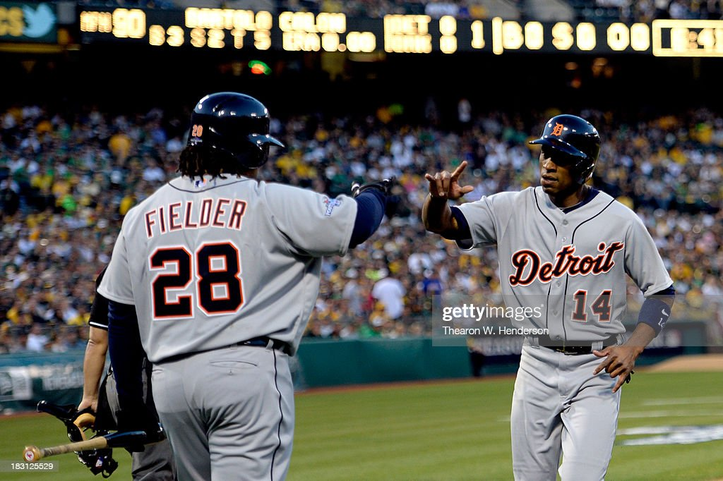 <a gi-track='captionPersonalityLinkClicked' href=/galleries/search?phrase=Austin+Jackson&family=editorial&specificpeople=608633 ng-click='$event.stopPropagation()'>Austin Jackson</a> #14 of the Detroit Tigers high fives Prince Fielder #28 after scoring on Miguel Cabrera #24 signle against Bartolo Colon #40 of the Oakland Athletics in the first inning during Game One of the American League Division Series at O.co Coliseum on October 4, 2013 in Oakland, California.