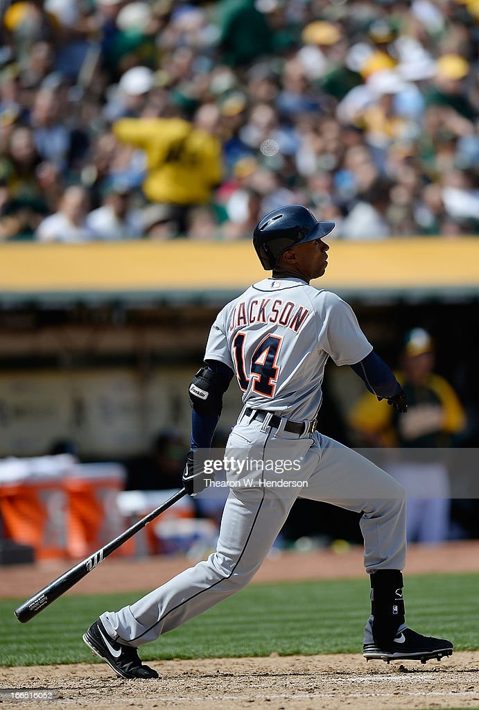 <a gi-track='captionPersonalityLinkClicked' href=/galleries/search?phrase=Austin+Jackson&family=editorial&specificpeople=608633 ng-click='$event.stopPropagation()'>Austin Jackson</a> #14 of the Detroit Tigers hits an RBI double, driving in Brayan Pena #55 against the Oakland Athletics in the six inning at O.co Coliseum on April 13, 2013 in Oakland, California.