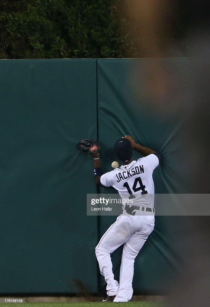 <a gi-track='captionPersonalityLinkClicked' href=/galleries/search?phrase=Austin+Jackson&family=editorial&specificpeople=608633 ng-click='$event.stopPropagation()'>Austin Jackson</a> #14 of the Detroit Tigers hits the centerfield wall attempting to make the play on the Carlos Santana #41 of the Cleveland Indians inside the park home run during the eighth inning of the game at Comerica Park on August 31, 2013 in Detroit, Michigan. The Tigers defeated the Indians 10-5.