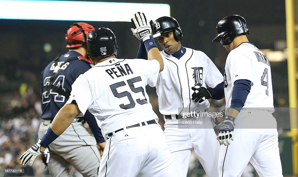 Austin Jackson #14 of the Detroit Tigers is congratulated by his teammes after hitting a three-run home run in the third inning scoring Brayan Rena #55 and Omar Infante #4 during the game against the Atlanta Braves at Comerica Park on April 28, 2013 in Detroit, Michigan.