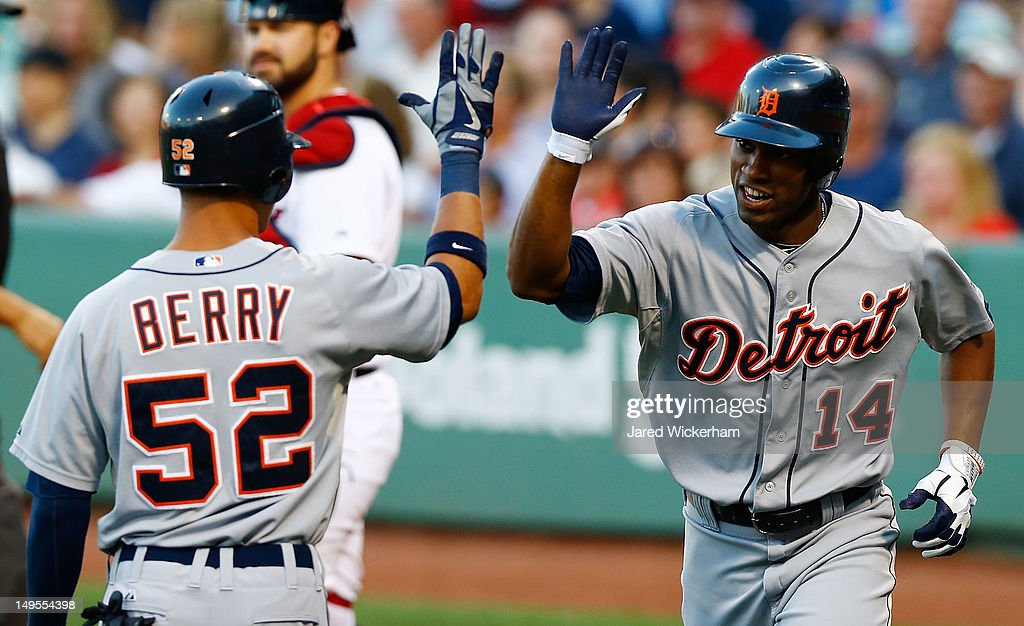 <a gi-track='captionPersonalityLinkClicked' href=/galleries/search?phrase=Austin+Jackson&family=editorial&specificpeople=608633 ng-click='$event.stopPropagation()'>Austin Jackson</a> #14 of the Detroit Tigers is congratulated by teammate Quintin Berry #52 after scoring against the Boston Red Sox in the first inning during the game on July 30, 2012 at Fenway Park in Boston, Massachusetts.