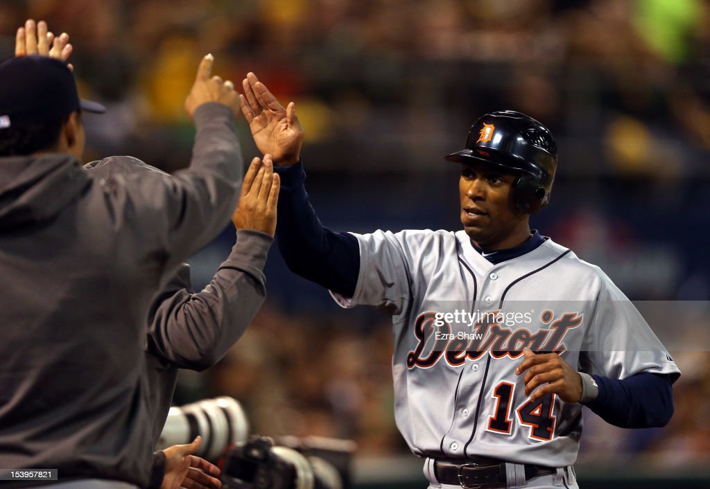 <a gi-track='captionPersonalityLinkClicked' href=/galleries/search?phrase=Austin+Jackson&family=editorial&specificpeople=608633 ng-click='$event.stopPropagation()'>Austin Jackson</a> #14 of the Detroit Tigers is congratulated in the dugout after scoring on a wild pitch in the third inning against the Oakland Athletics in Game Five of the American League Division Series at O.co Coliseum on October 11, 2012 in Oakland, California.