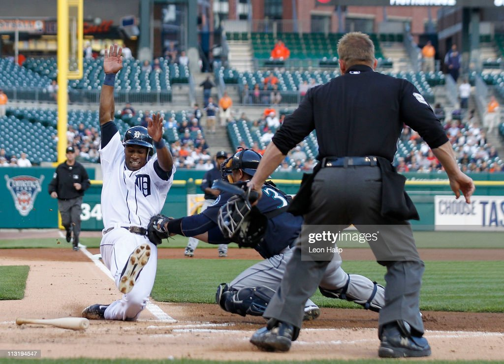 <a gi-track='captionPersonalityLinkClicked' href=/galleries/search?phrase=Austin+Jackson&family=editorial&specificpeople=608633 ng-click='$event.stopPropagation()'>Austin Jackson</a> #14 of the Detroit Tigers is tagged out at home by <a gi-track='captionPersonalityLinkClicked' href=/galleries/search?phrase=Miguel+Olivo&family=editorial&specificpeople=209185 ng-click='$event.stopPropagation()'>Miguel Olivo</a> #30 of the Seattle Mariners in the first inning at Comerica Park on April 26, 2011 in Detroit, Michigan.