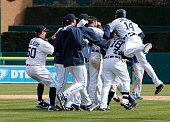 Austin Jackson of the Detroit Tigers jumps on teammates after Ian Kinsler drove him in with a 10th inning RBI single to beat the Kansas City Royals...