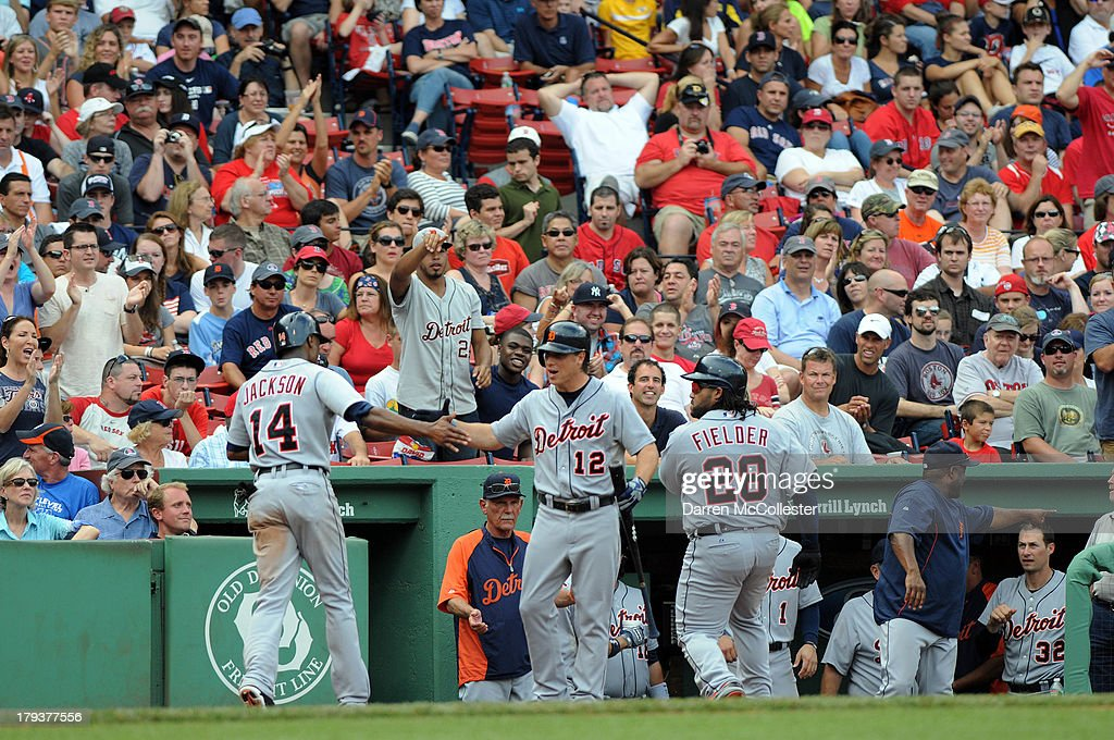 <a gi-track='captionPersonalityLinkClicked' href=/galleries/search?phrase=Austin+Jackson&family=editorial&specificpeople=608633 ng-click='$event.stopPropagation()'>Austin Jackson</a> #14 of the Detroit Tigers receives high fives after scoring a run from teamates <a gi-track='captionPersonalityLinkClicked' href=/galleries/search?phrase=Andy+Dirks&family=editorial&specificpeople=7511216 ng-click='$event.stopPropagation()'>Andy Dirks</a> #12 and <a gi-track='captionPersonalityLinkClicked' href=/galleries/search?phrase=Prince+Fielder&family=editorial&specificpeople=209392 ng-click='$event.stopPropagation()'>Prince Fielder</a> #28 in the eighth inning against the Boston Red Sox at Fenway Park on September 2, 2013 in Boston, Massachusetts.