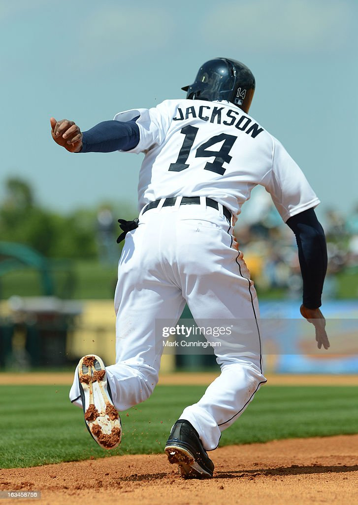 <a gi-track='captionPersonalityLinkClicked' href=/galleries/search?phrase=Austin+Jackson&family=editorial&specificpeople=608633 ng-click='$event.stopPropagation()'>Austin Jackson</a> #14 of the Detroit Tigers runs the bases during the spring training game against the Pittsburgh Pirates at Joker Marchant Stadium on March 2, 2013 in Lakeland, Florida. The Tigers defeated the Pirates 4-1.
