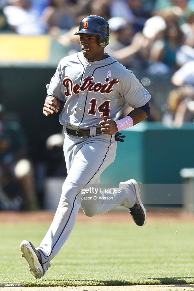 <a gi-track='captionPersonalityLinkClicked' href=/galleries/search?phrase=Austin+Jackson&family=editorial&specificpeople=608633 ng-click='$event.stopPropagation()'>Austin Jackson</a> #14 of the Detroit Tigers scores a run against the Oakland Athletics during the ninth inning at O.co Coliseum on May 13, 2012 in Oakland, California. The Detroit Tigers defeated the Oakland Athletics 3-1.
